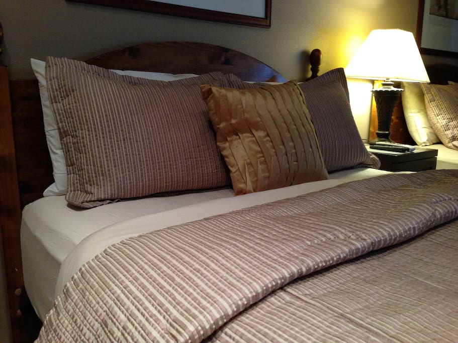 Comfy queen beds with down duvets and quality linens
