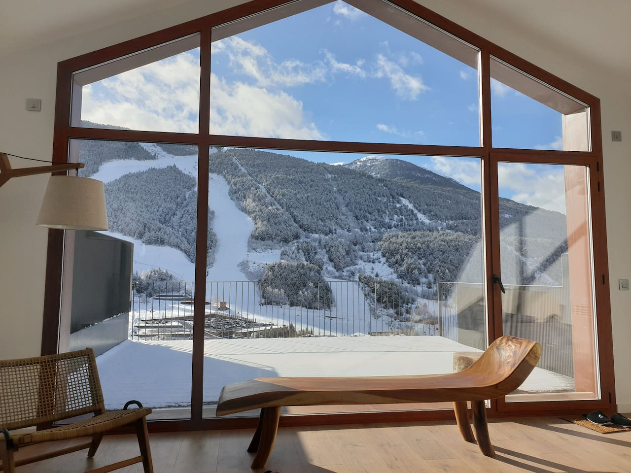 Modern 3 bedroom chalet on the hills of El Tarter with amazing views over the slopes of Grandvalira.  The living room features wall to wall and floor to ceiling windows, with access to a large private terrace.  Kabano Vacation Rentals Andorra