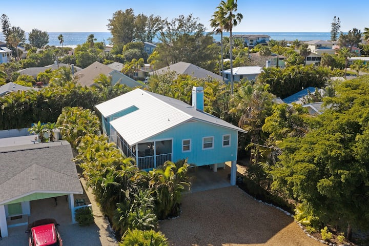 Dog-friendly beach bungalow with private, heated pool, balcony, and lanai