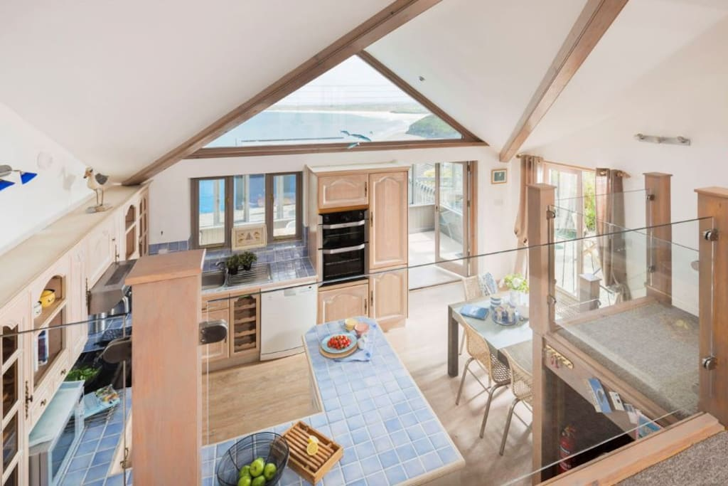 The spacious open plan living room overlooks the airy kitchen diner, both with spectacular ocean views.