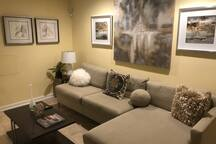 Kick back and relax in this home's comfortable living area while enjoying incredible pieces of modern artwork.