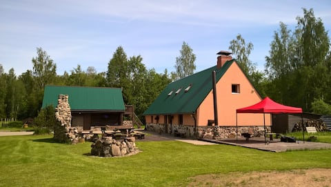 """Vacation home """"VECUPMAĻI"""" in the woods"""