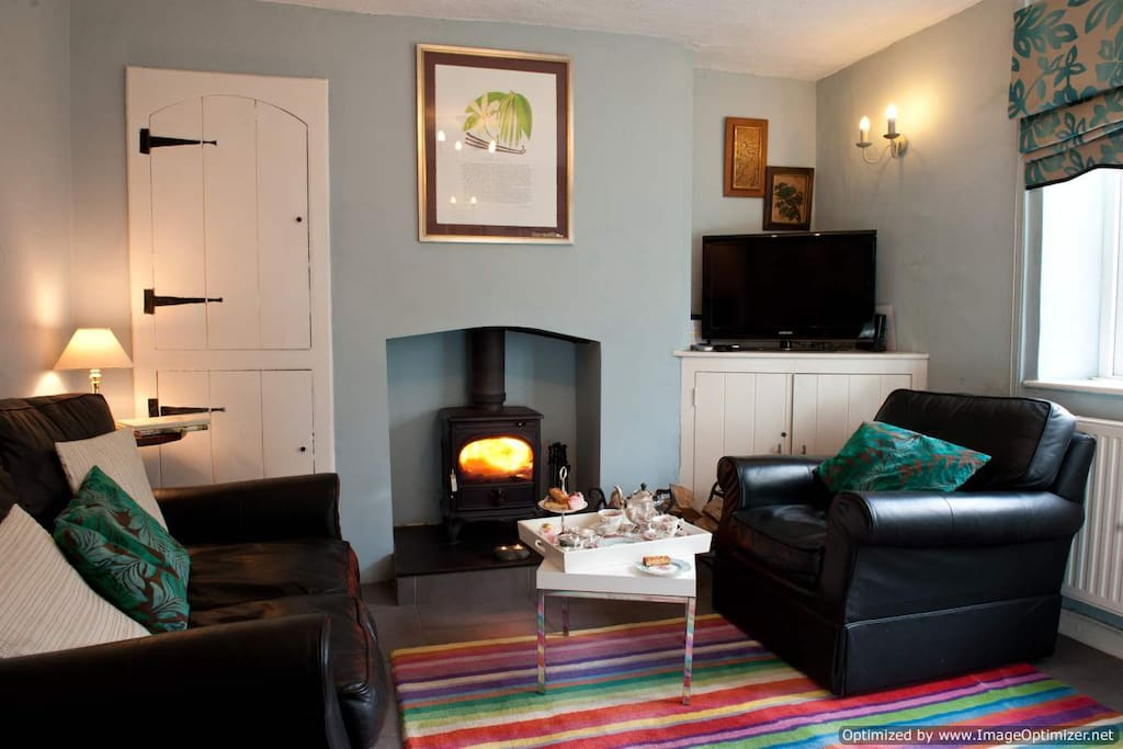 Cosy sitting room with woodburner and good quality TV