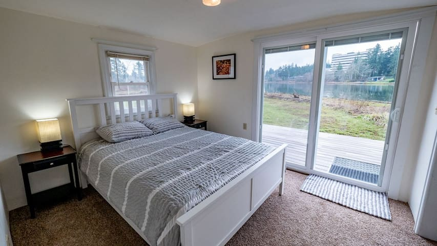 Bedroom looks out to the water & has sliding door out to the deck.