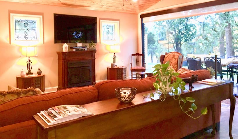 """LIVING AREA includes 55"""" flatscreen tv, gas fireplace, large sectional sofa, ceiling fan, and activity closet."""