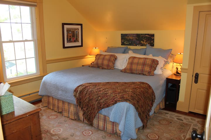 The cozy bedroom 1 has a King bed, roomy closet, dresser and reading chair.