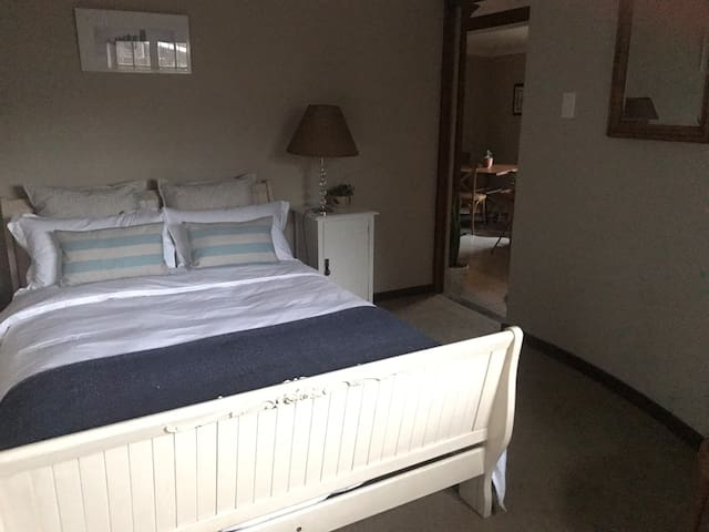 Comfortable double bed with side table and night lamp