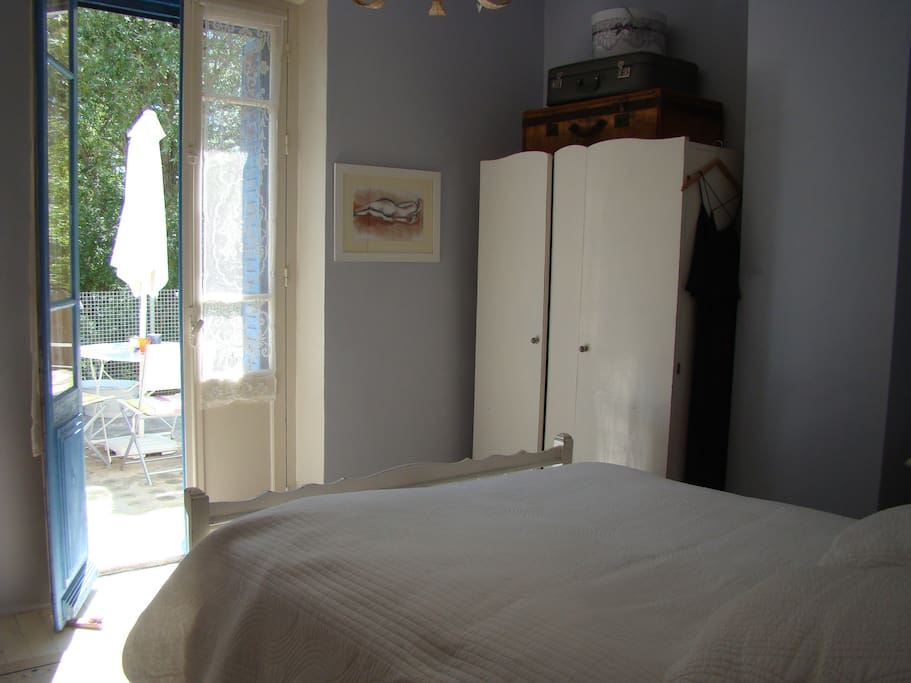 Master bedroom with doors opening onto upper terrace.