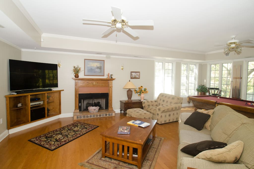 The living room is spacious, plenty of seating and a pool table