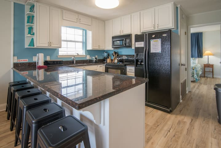 Fully equipped kitchen to cook yummy meals. with 5 bar stools.