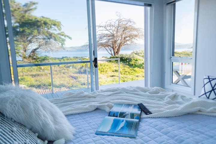 Downstairs Master King bedroom with views around the bay.