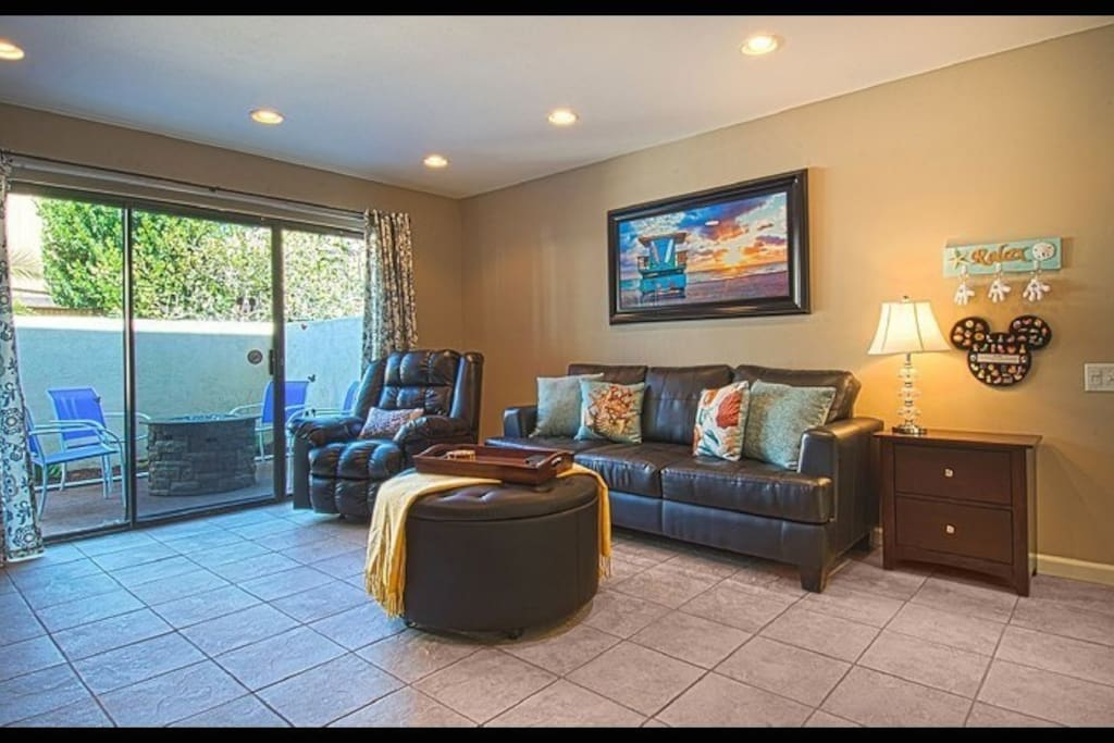 Large living room with Lazy Boy chair and Pull out sofa bed.