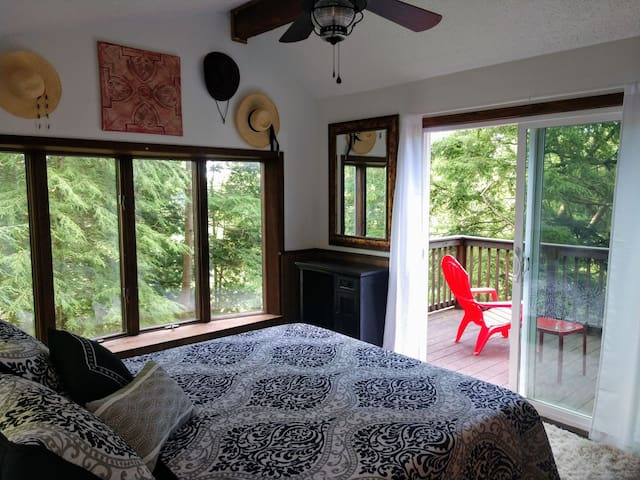 Bedroom on the main floor with small deck