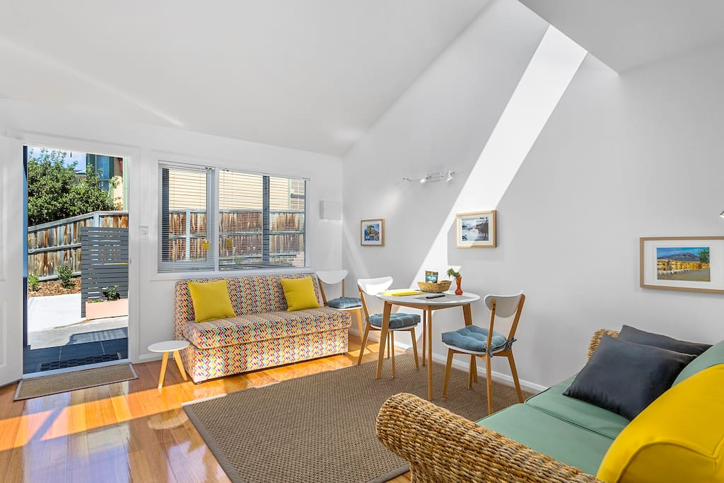 Bright and sunny outlook with raked ceiling, feature skylight and beautiful floors
