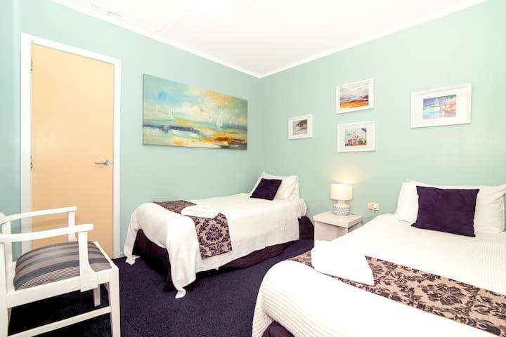 Upper Beachfront Apartment ~ second bedroom - 2 x twin beds
