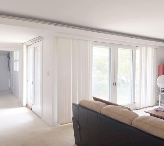 Living room features abundant natural sunshine