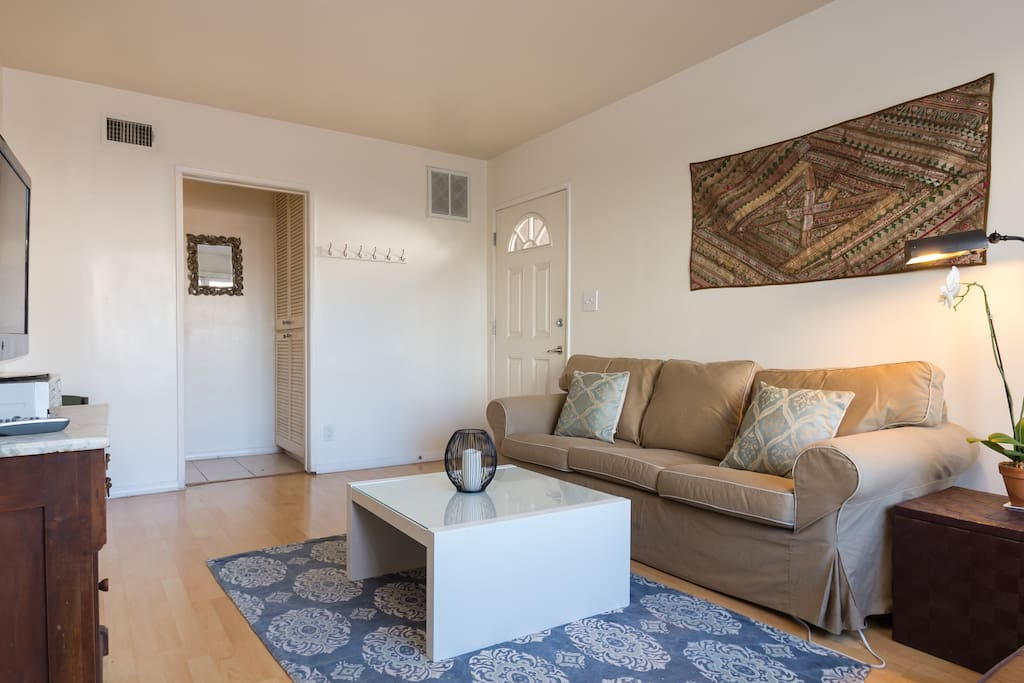 Bright spacious living room with cozy couch and futon, basic local TV and plenty of awesome DVDs to watch!