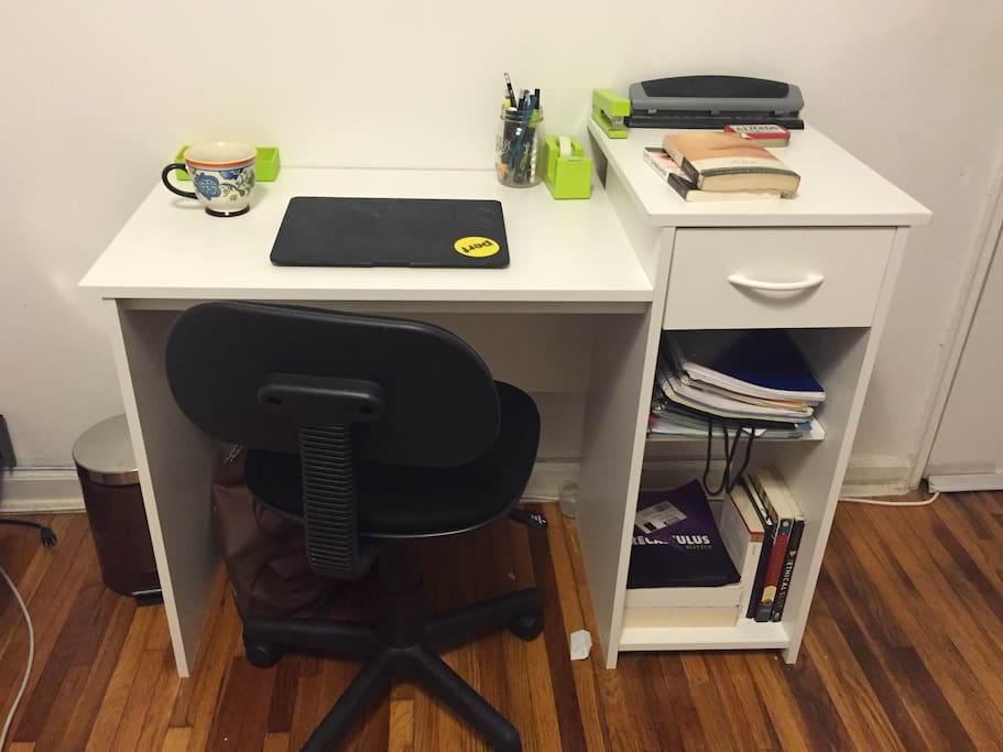 Desk with chair and utilities.