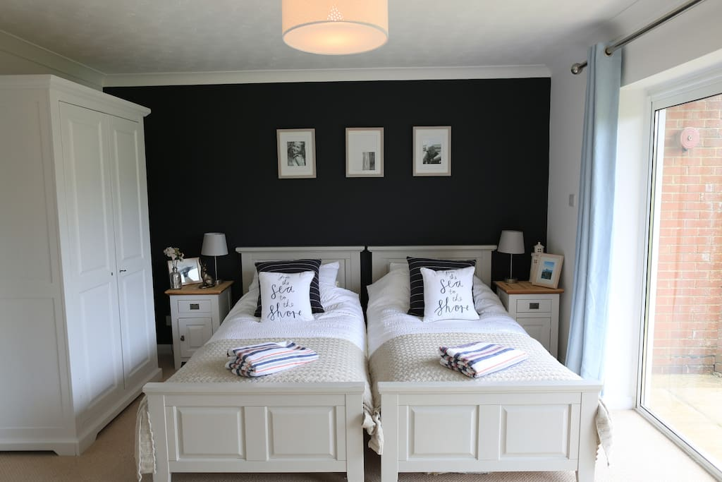 Ground floor twin bedroom with TV and games console