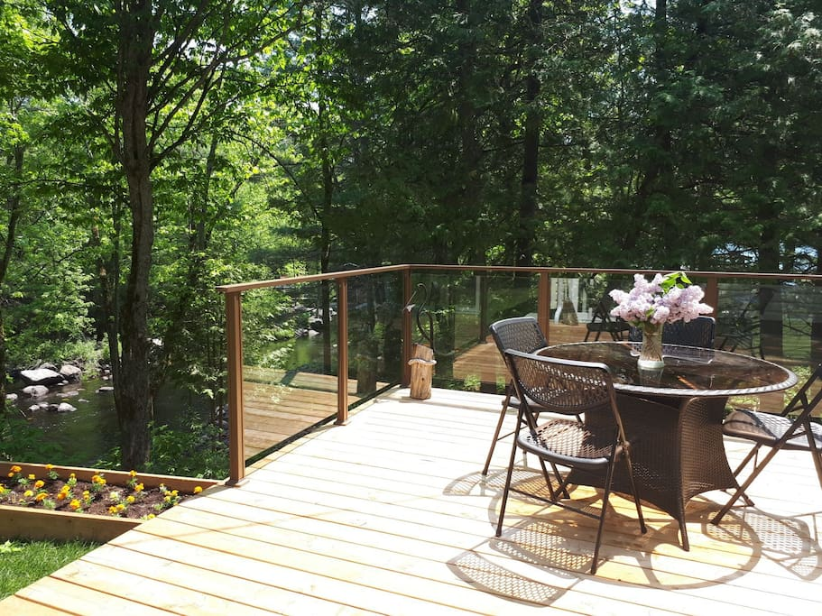 Private deck with views of Deer River. Relax and enjoy nature.