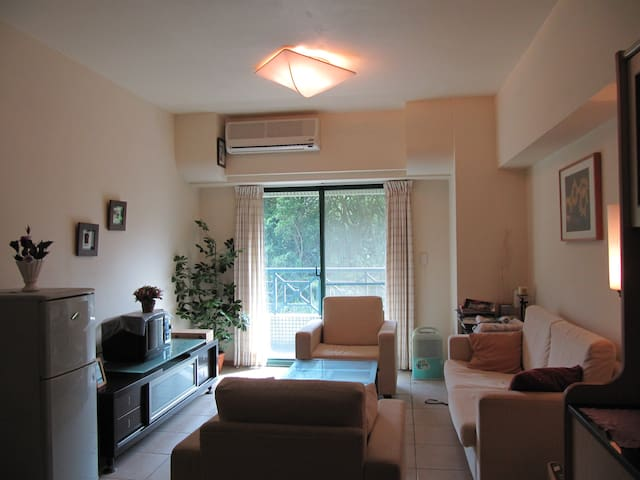溫泉度假屋 近陽明一樓即有男湯和女湯 從位在的4樓陽台即可遠眺美麗海景 - Jinshan District - Huoneisto
