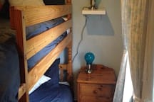 Our bunk room with adult sized bunk beds. Compact but extremely comfortable !