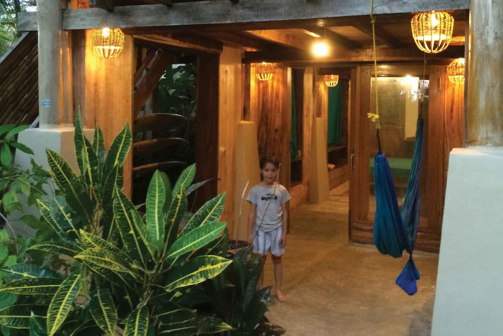 GREEN TRIPLE ROOM (downstairs ~ under the Family Surf Room ~ Ideal for 2 persons)  •Bedroom 3x6m2  •1queen size bed with mosquito net  •1Single Bed with mosquito net •Verandah 3x3m2, 1 hammock  •Bathroom 2x3m2, western standard toilet, cold shower, sink and mirror  •Aircond.  •In-room safety box  •Writing desk •Breakfast for 3 persons