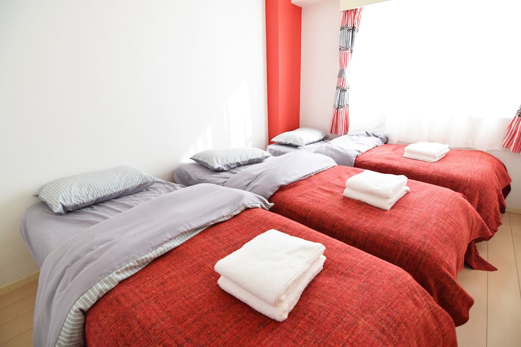 Bed Room 1 with 3 single beds.