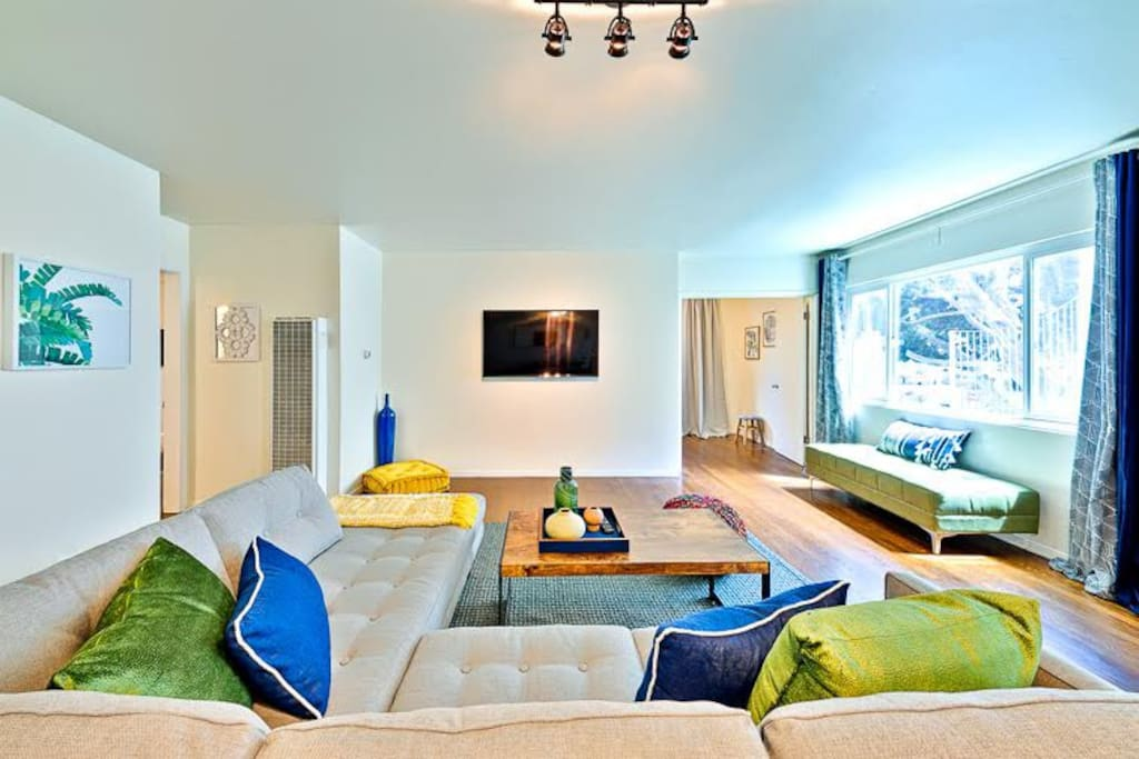 Beautiful beach inspired colors brighten up the spacious great room with large windows.