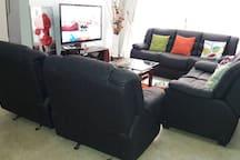 sitting room area fully furnitured with elagant  leather  sofa set.