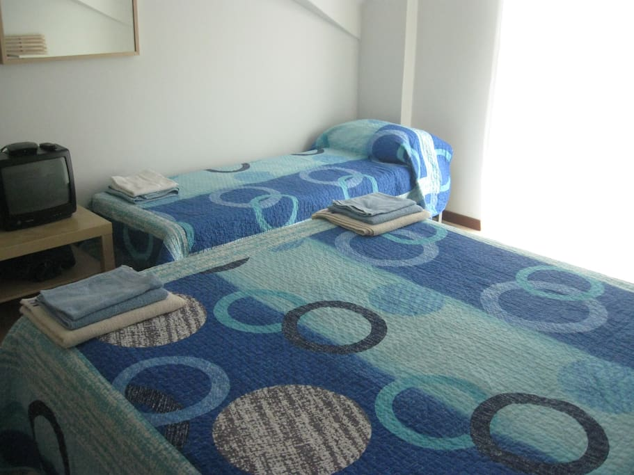 room with a double bed and a single