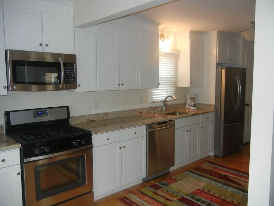 New, updated kitchen with stainless steel appliances and granite counters.