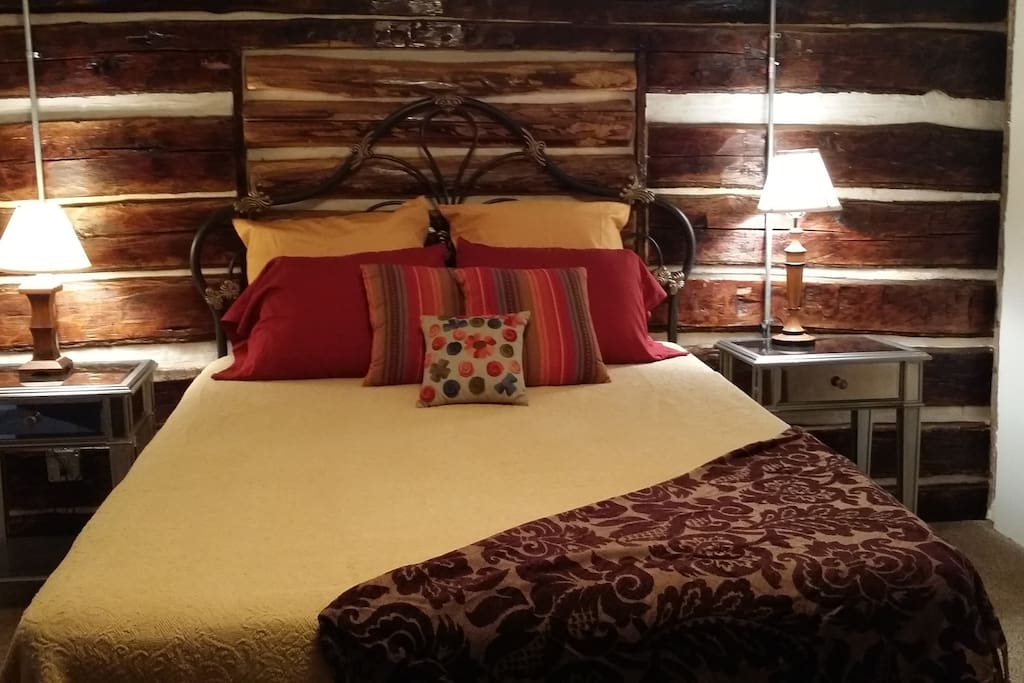 Queen bed with access to private full bath.  Room is original 1880s cabin!