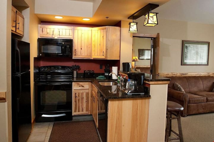 Cook delicious meals in the fully equipped kitchen with lovely wood cabinets