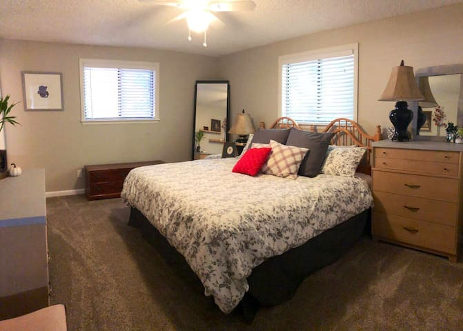 Master bedroom with comfortable king bed and master-bath.