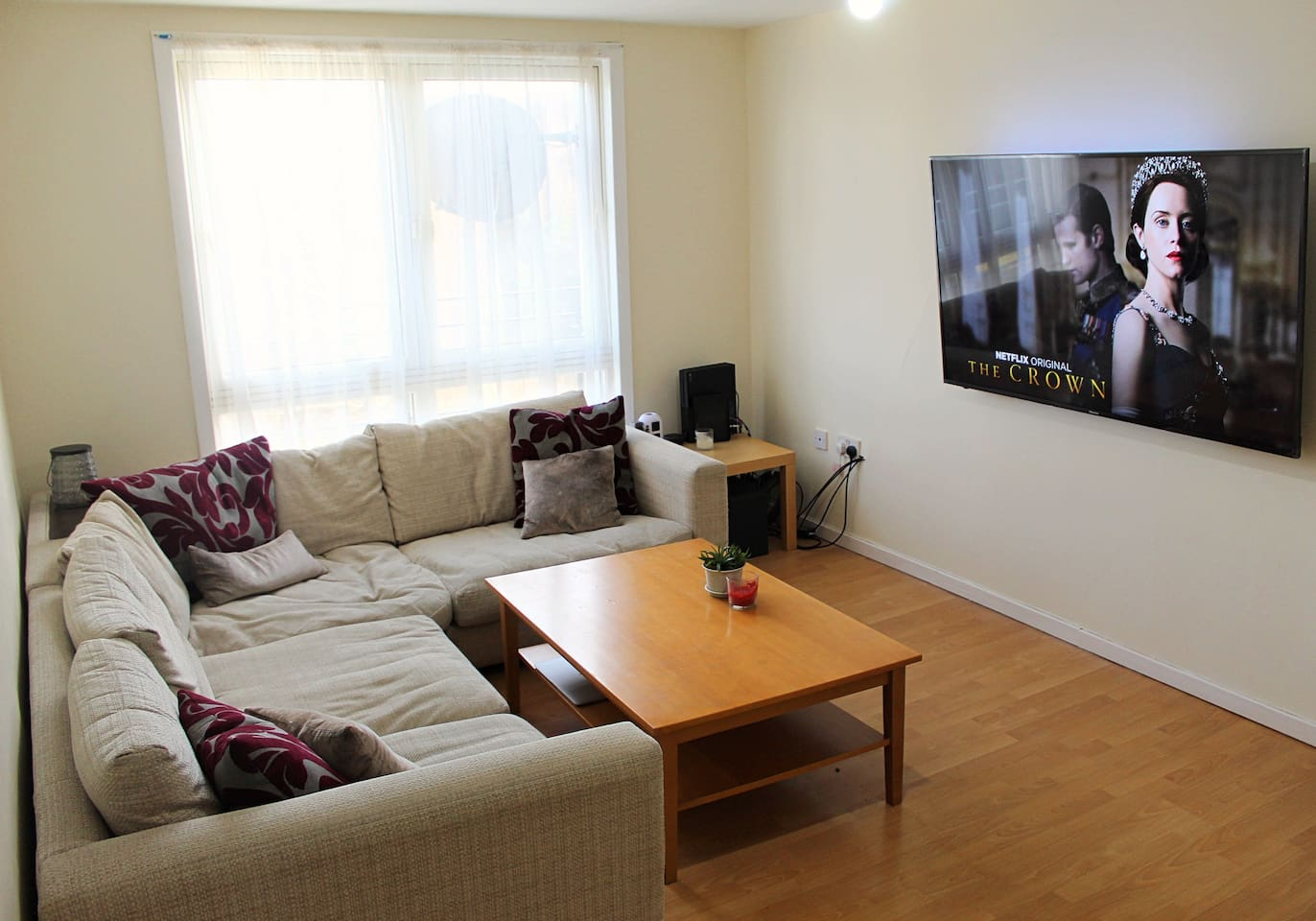Clean and spacious living room that overlooks the pentland hills in the distance.