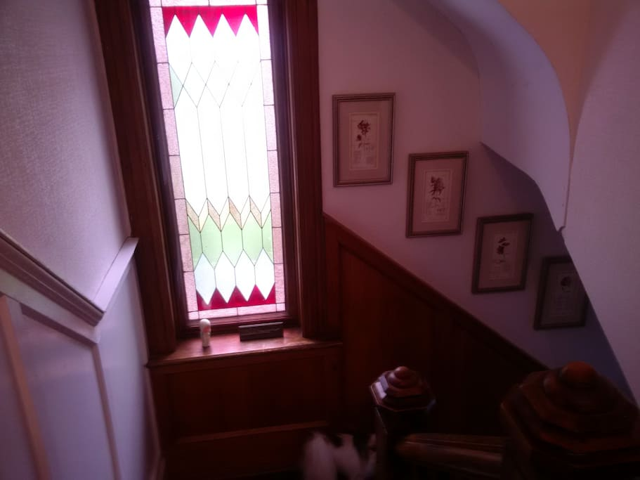 Four stain glass windows, three in the living room and this one on the landing.
