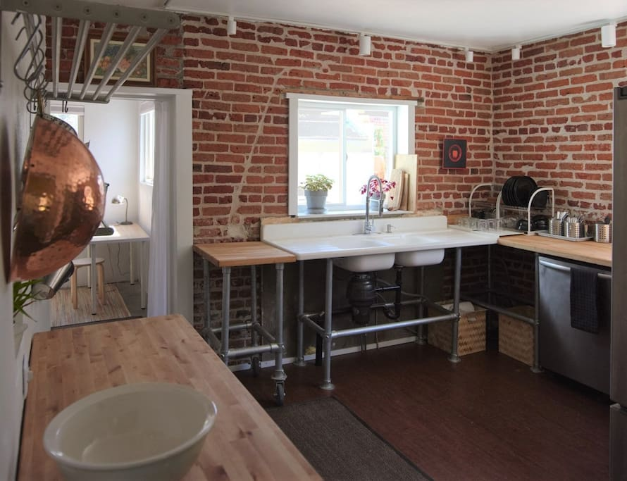 """The newly exposed brick in the kitchen was sourced over a century ago from the """"Hogbacks"""" a geological feature of Rocky Mountain foothills.  A beautiful preview of the colors that gave the state its name."""