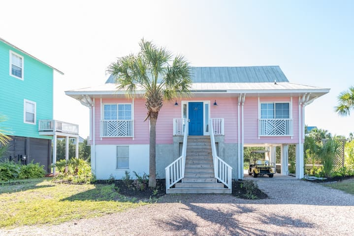 Two-bedroom cottage on Harbor Island, with creek views & golf cart.