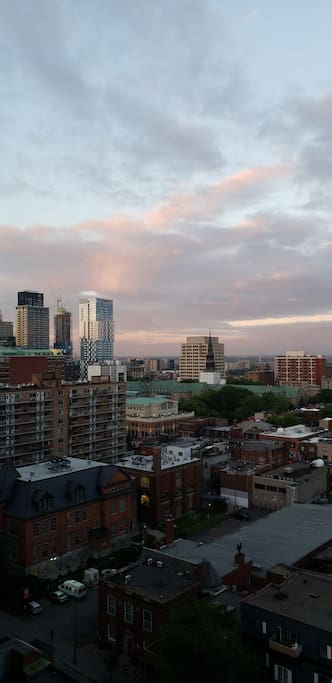 Sunset over some of Montreal's skyrise (Tour des Canadiens is visible)