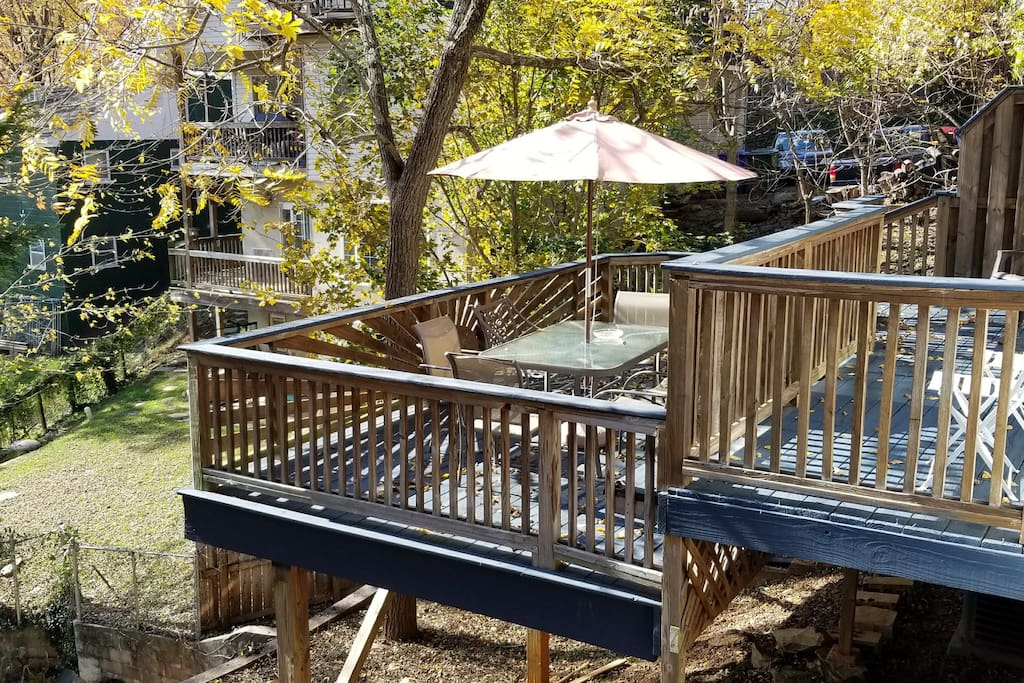 Dual-level back deck provides a great gathering space in the trees, just minutes to downtown