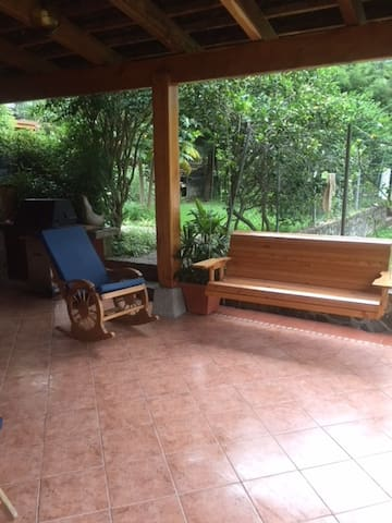 Porch swing and rockers are great for relaxing.