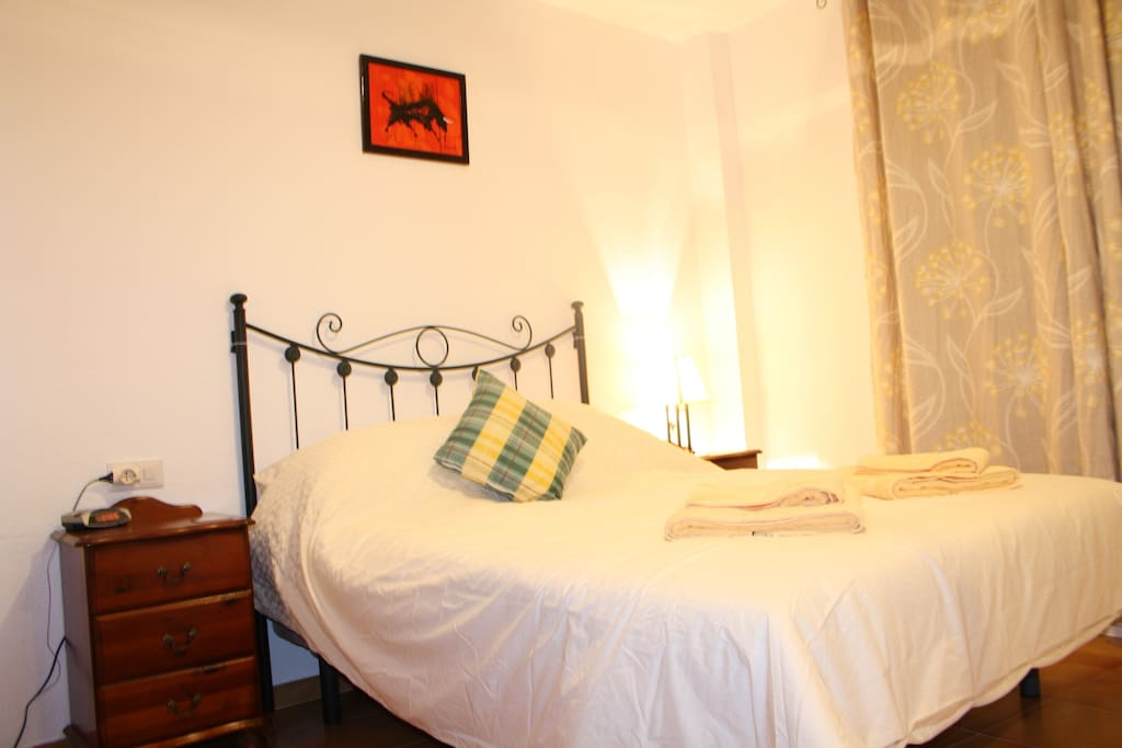 The bedroom with comfortable king-sized double bed.