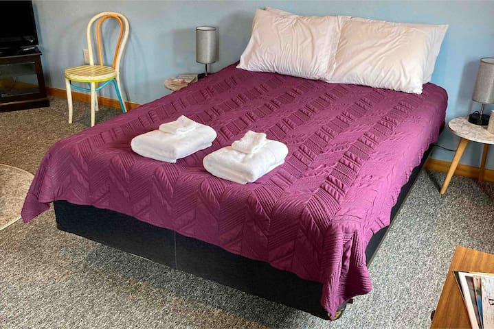 Queen sized bed in the HUGE, spacious bedroom with sitting areas and 27 inch LCD Flatscreen