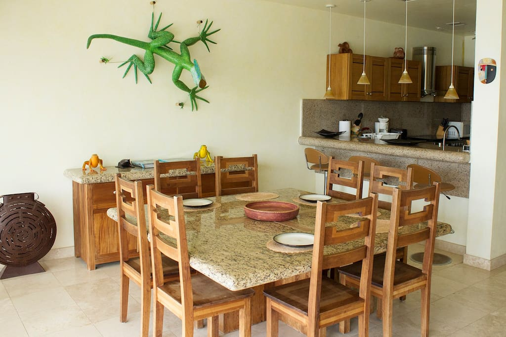Dining table and open kitchen with ocean view