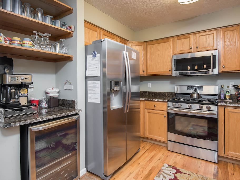 Kitchen with extra beverage fridge