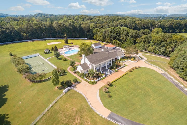 Aerial view of the grounds, tennis court, pool, Mansion, etc.