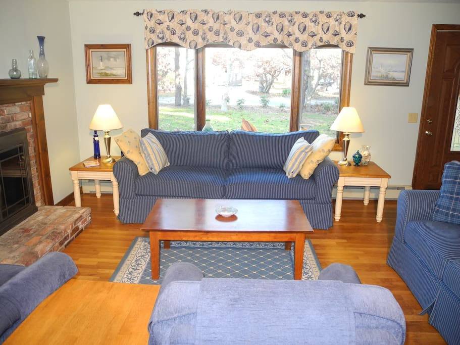Bright, comfortable living room with ample seating.