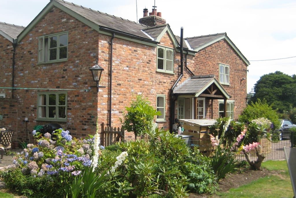 country cottage set in private garden , South facing.