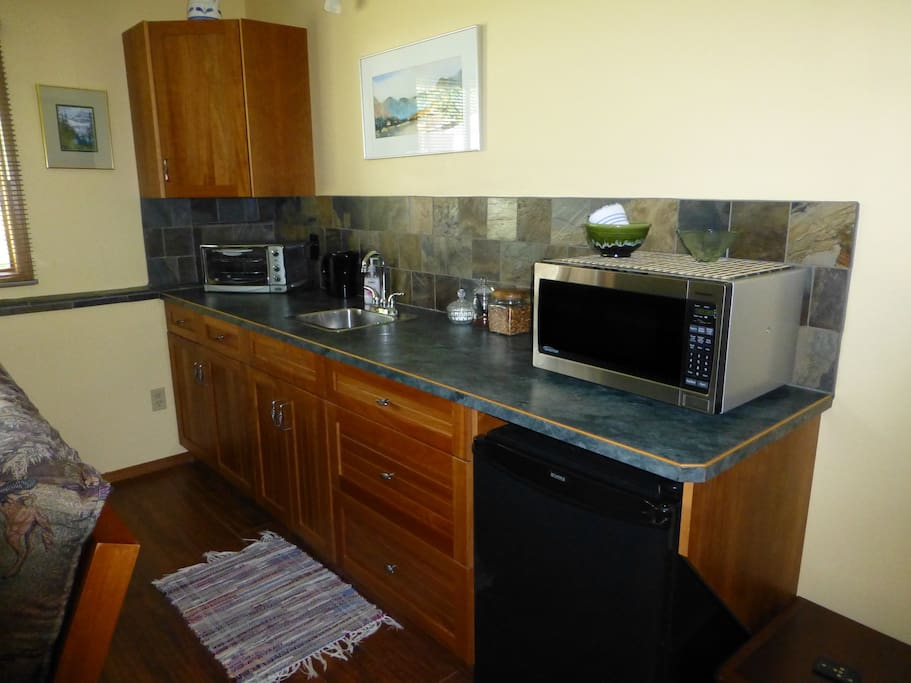 The kitchen has microwave, toaster oven, hotplate, coffee maker etc.